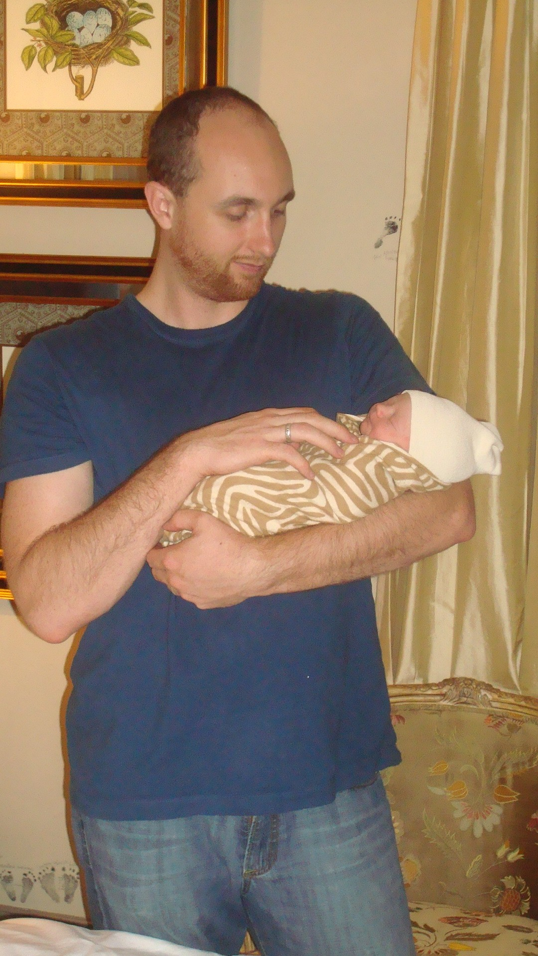 Jesse holding Gregory for the first time