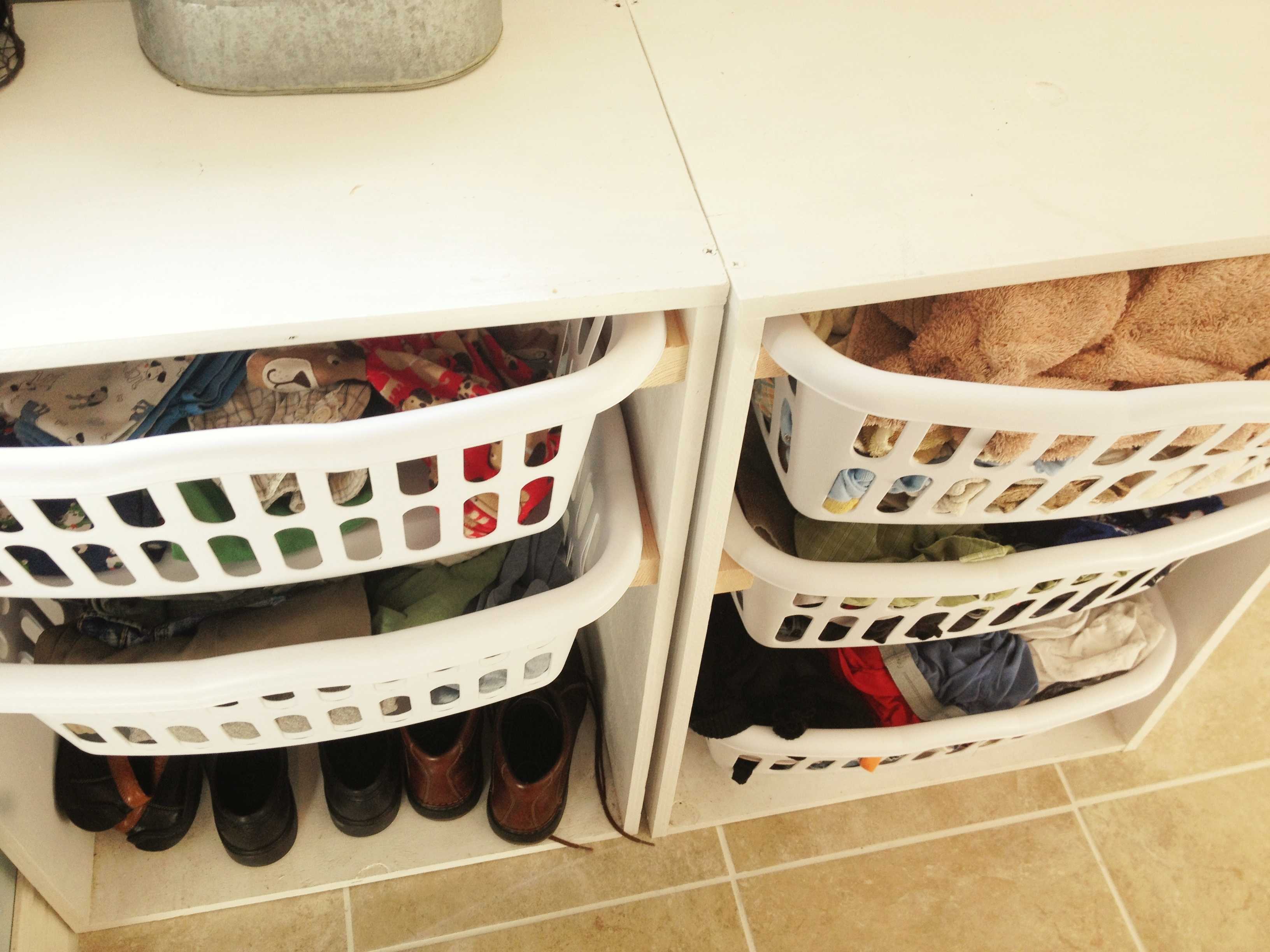 Clean folded laundry on the left sorted by room in the house, dirty on the right pre-sorted by color