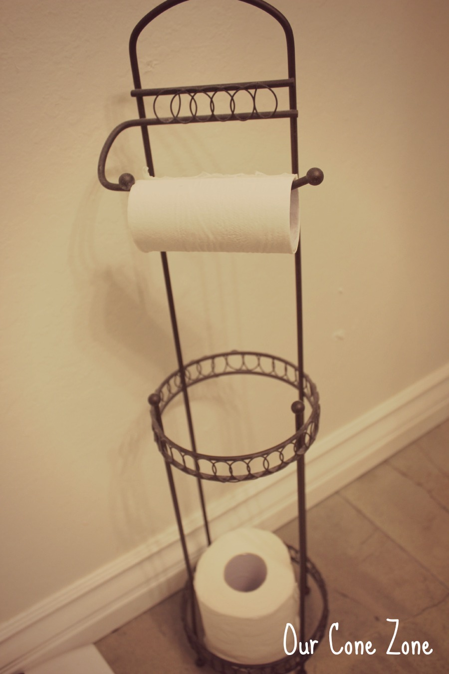 Upstairs Bathroom orb toilet paper holder