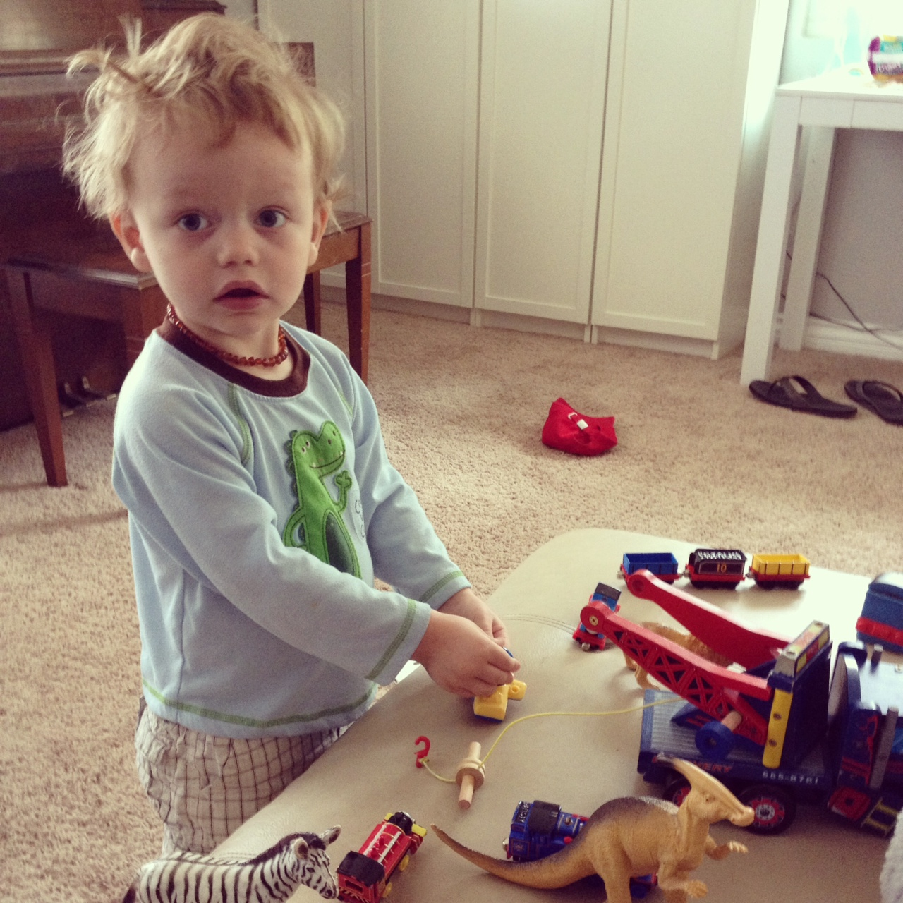 Gregory playing with trains