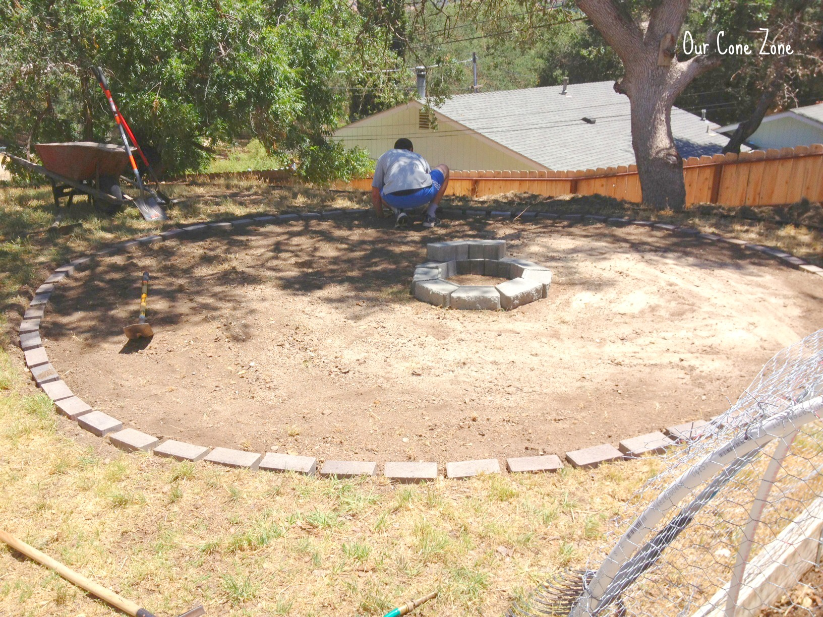 Making a fire pit laying bricks