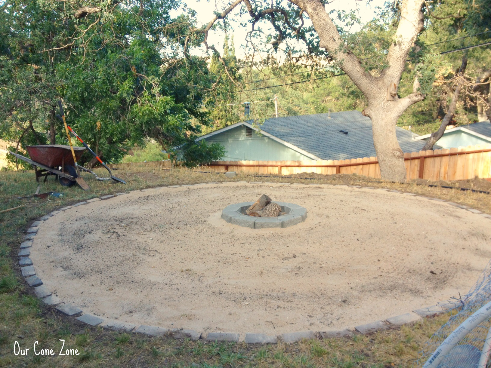 Making a fire pit spreading sand