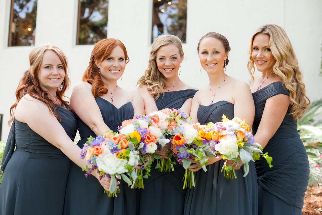 bridesmaids with bright flowers and gray dresses