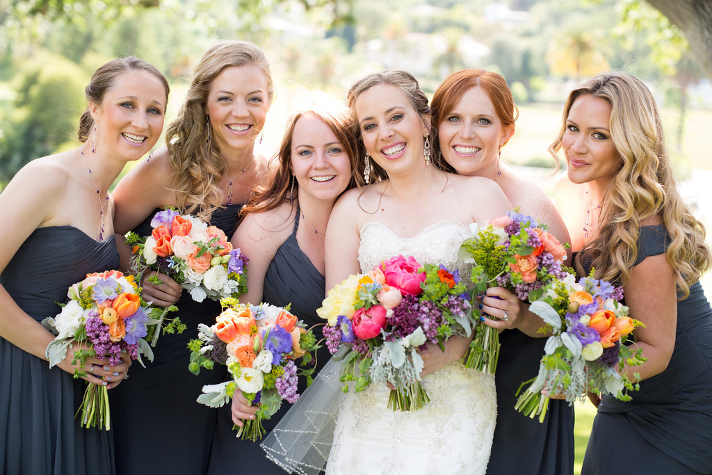bridesmaids with bright flowers