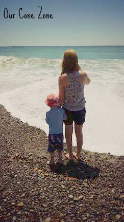 Gregory and Momma at beach in waves