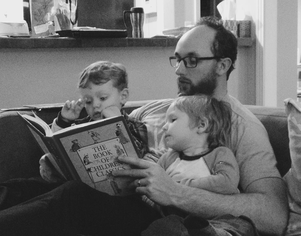 Jesse reading to boys