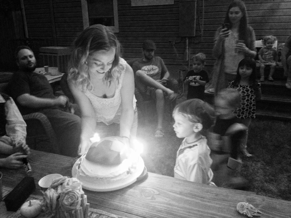 Gregorys party blowing out candles